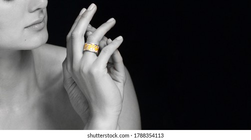 woman hand. woman hands and face. fashion accessories ring on finger woman fashion portrait on black background.