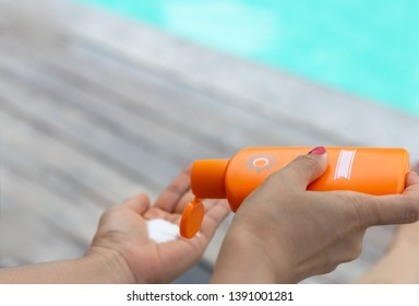 woman hand with healthy skin applying sunscreen to shoulder which she is  protection of sunburn and cancer prevention concept.