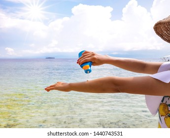 Woman hand  and healthy skin applying sunscreen to shoulder which she is  protection of sunburn and cancer prevention concept.