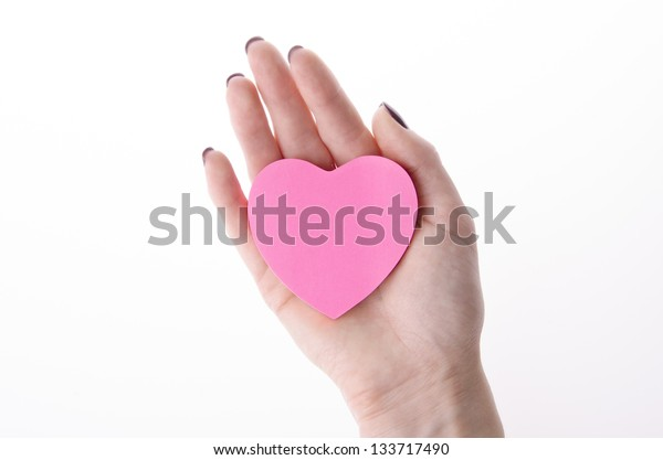 woman hand with a heart shaped paper