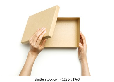 Woman hand hold a craft gift box isolated on white.