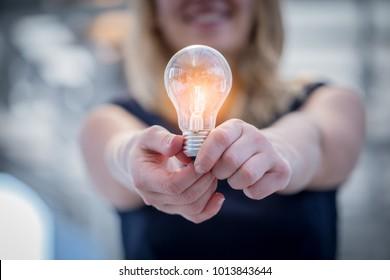 woman hand hold light bulb creativity ideas concept