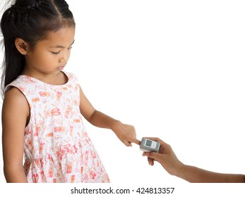 woman hand hold pulse oximeter for little asia girl used to measure pulse rate and oxygen levels , Patient with pulse oximeter on finger for monitoring