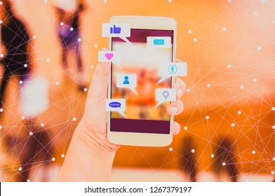 Woman hand hold Smartphone share social media, with  blurred backgrounds department stores and bokeh, concept  lifestyle and online wireless networks.