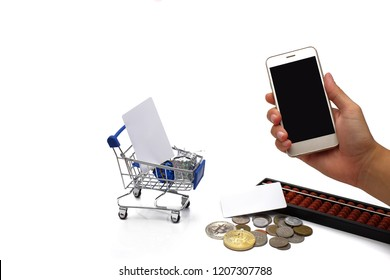 woman hand hold and touch screen smart phone .With Card and gift in shopping cart , global money coin ,Gold & Silver bitcion cion and abacus on the floor.