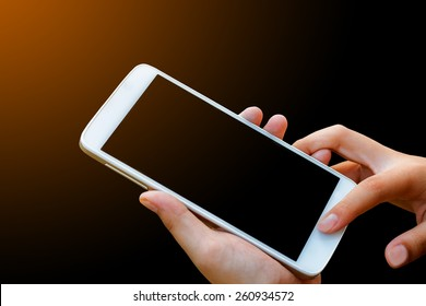 woman hand hold and touch screen smart phone,tablet,cellphone isolated on black , abstract background for mobile banking,online banking concept.