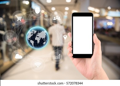 woman hand hold and touch screen smart phone with tech icon flow, tablet,cellphone over blurred background;Transactions by smartphone concept