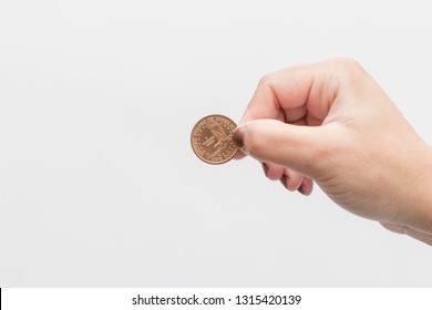 woman hand holding 1 dollar coin from Sacagawea