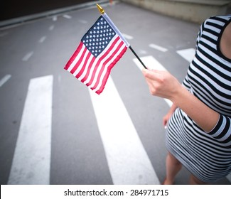 woman hand holding american flag.