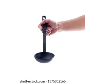 woman hand holding black ladle dipper isolated on white background