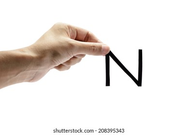 woman hand holding the black letter n, isolated on white background