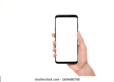 Woman hand holding the black smartphone blank screen with modern frameless design isolated on white background