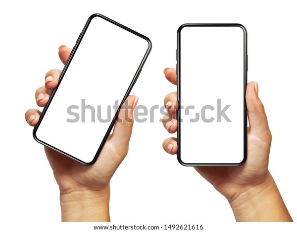 Woman hand holding the black smartphone with blank screen and modern frameless design two positions angled and vertical - isolated on white background