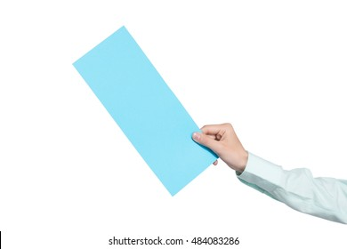 woman hand holding blank airline boarding pass ticket isolated over white background