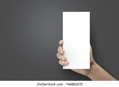 Woman hand holding a blank brochure booklet mock up on a black background.