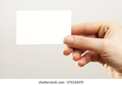 Woman hand holding blank business card