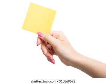 Woman hand holding blank yellow notepaper on over white background