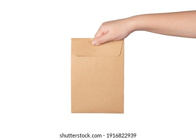 Woman hand holding brown paper bag isolated on white background.