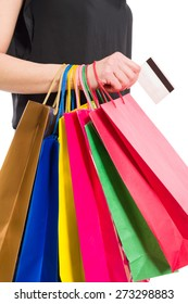 Woman hand holding bunch of shopping bags and credit or debit card
