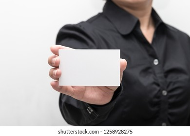 Woman hand holding a business card