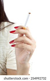 The woman hand is holding cigarette on white background.