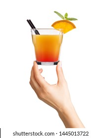 Woman hand holding cocktail in old fashioned glass with ice cubes and black straw on white background.