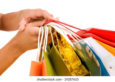 Woman hand holding colorful bags.