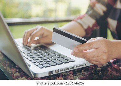 woman hand holding credit card and using laptop making online payment online, online shopping