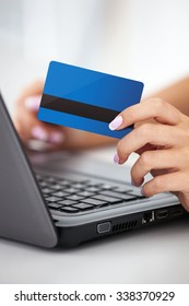 Woman hand holding credit card - Online shopping concept.