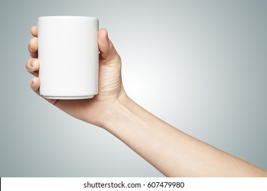 Woman hand holding a cup