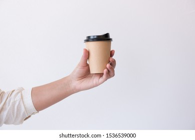 Woman hand holding disposable cup hot espresso coffee menu isolated on white background.Hot drink menu for customer in the coffee shop or restaurant.