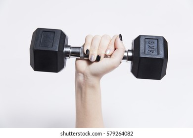 woman hand holding dumbbell