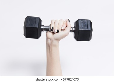 woman hand holding dumbell