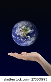 Woman hand holding Earth planet, Elements of this image furnished by NASA