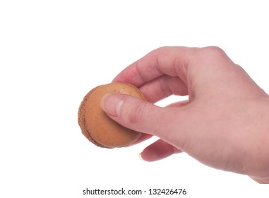 Woman hand holding or giving macaroon cookie isolated