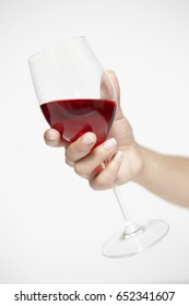 Woman hand holding glass on red wine