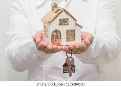Woman hand holding house model