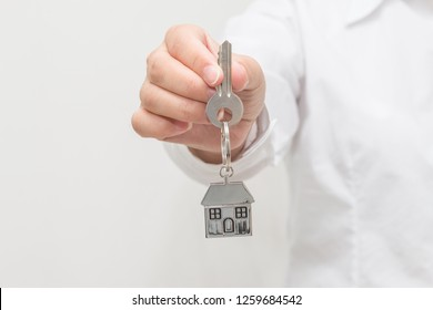 Woman hand holding house model and key