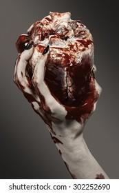 Woman hand holding a human heart