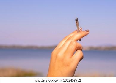 Woman hand holding a marijuana joint