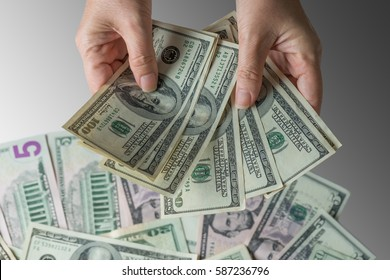 Woman hand holding money,bribery concept.Business woman giving stack of US dollar.