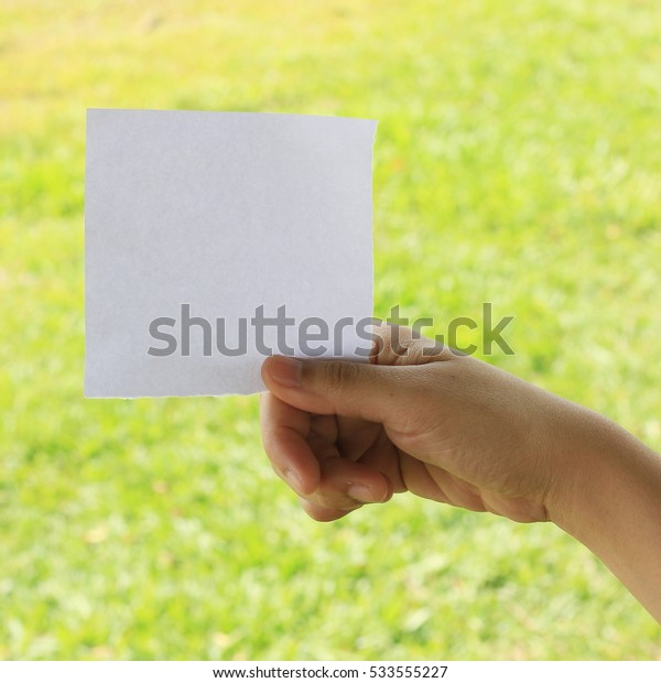 Woman hand holding note paper with space for text