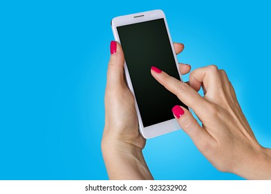 Woman hand holding the phone on blue background