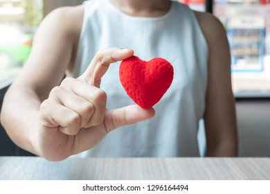 woman hand holding  Red heart shape in office. Love, Happy Valentines day holiday and healthy Insurance concept