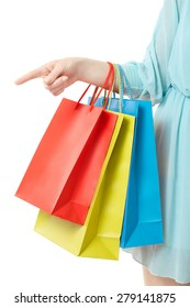 Woman hand holding shopping bags, pointing at isolated on white, clipping path included