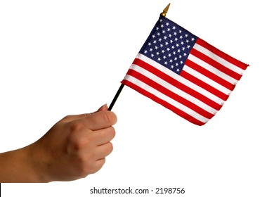 Woman hand holding a small patriotic American US flag isolated on white