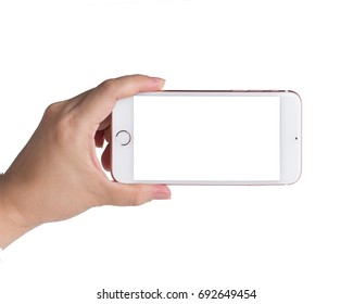 Woman hand holding smartphone with blank screen isolated on white