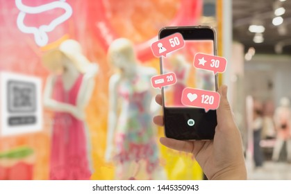 Woman hand holding Smartphone share social media, with  blurred backgrounds shop in department and bokeh, concept  lifestyle and Communication and online systems with modern wireless technology