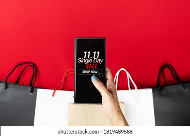 woman hand holding smartphone with shopping bag, China 11.11 single day sale concept - Shutterstock ID 1819489586
