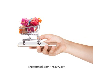 woman hand holding smartphone and shopping cart